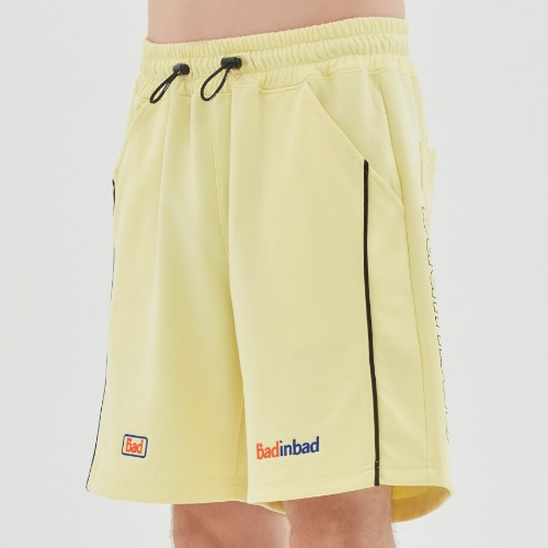 TRACK HALF SHORTS_LIME YELLOW